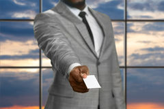 Black businessman giving visit card. Stock Image