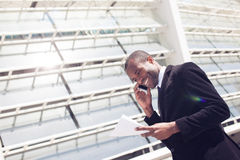 Black businessman have phone conversation Stock Images