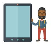 Black businessman holding a big screen tablet Stock Image