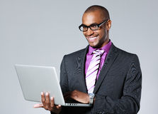 Black businessman with laptop Stock Photography