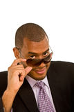 Black Businessman Looking Over his Sunglasses Stock Photography