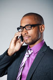 Black businessman with mobile Stock Image