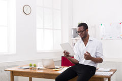 Black businessman in modern office, work with tablet Royalty Free Stock Photo