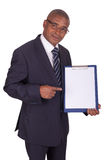 Black businessman with panel Royalty Free Stock Photography