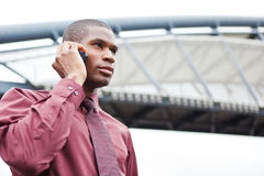 Black businessman on the phone. A shot of a black businessman on the phone Royalty Free Stock Photography