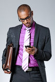 Black businessman with phone Stock Image