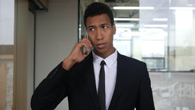 Black Businessman Phone Negotiation, Dialing and Talking Royalty Free Stock Photos