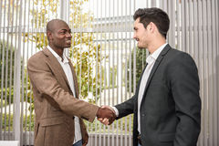 Black businessman shaking hands with a caucasian one Royalty Free Stock Photo