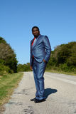 Black businessman standing on road stock images