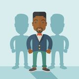 Black businessman standing straight with his. A very confident black guy standing straight showing that he has a strong teambuilding togetherness. Teamwork Stock Photo