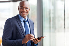 Black businessman tablet pc Royalty Free Stock Photo