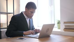 Black Businessman Upset by Loss while Working on Laptop. Young creative designer , good looking stock video