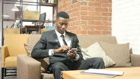 Black Businessman Using Smartphone, Indoor