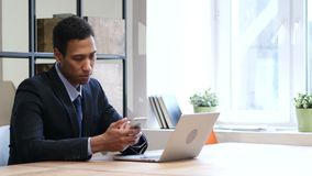 Black Businessman Using Smartphone, Online Browsing. Young creative designer , good looking stock footage