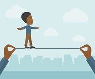Black Businessman walking on wire Stock Image