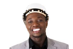 Black businessman wearing helmet Royalty Free Stock Image