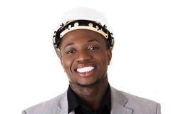 Black businessman wearing helmet Royalty Free Stock Image