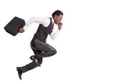 Black businessmen running Stock Images