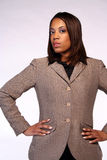 Black businesswoman. Fashionable black businesswoman with hands on hips, studio background Royalty Free Stock Photos