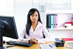 Black businesswoman at desk Royalty Free Stock Images