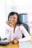 Black businesswoman at desk in office Stock Photos