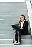 Black businesswoman with laptop Stock Image