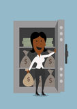 Black businesswoman opening bank safe Stock Photography
