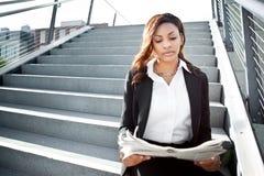 Black businesswoman reading newspaper Royalty Free Stock Photos