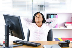 Black businesswoman resting at desk Stock Image