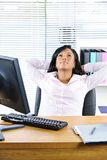Black businesswoman resting at desk Stock Photos
