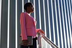 Free Black Businesswoman Standing Near Business Office Building. Stock Photos - 157311453