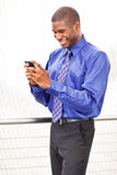 Black businesswoman texting Royalty Free Stock Image