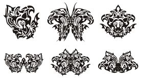 Black butterfly wing and decorative symbols from it Royalty Free Stock Photo