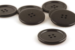 Black buttons. Against light background Stock Photo