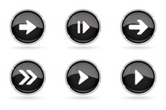 Black buttons with chrome frame. Round glass shiny 3d icons with arrows. Vector illustration isolated on white background Stock Photo