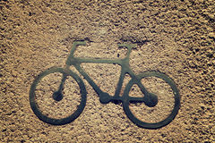 Black bycicle sign on lanes asphalt road. Stock Photography