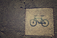 Black bycicle sign on lanes asphalt road. Stock Photo