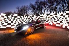Black C7 Corvette at night royalty free stock photos