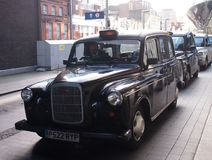 Black Cab in Birmingham, England. A black cab at Birmingham New Street Station, Great Britain stock photos