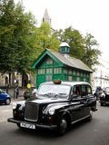 Black cab in London. A black London cab in Notting Hill stock image