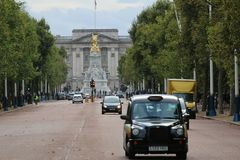 Black Cab in The Mall London. Black cab in the mall from Buckingham Palace in London,UK stock image