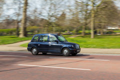 Black Cab on a Road in London Stock Photos