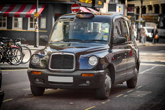 Black cab. Shiny black cab standing on the street of Central London stock photos