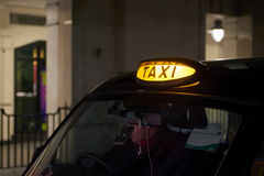 Black cab sign. Low key detail of London black cab sign turned on at night royalty free stock images