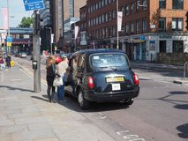 Black cab taxi in London. LONDON, UK - CIRCA JUNE 2018: Black cab taxi royalty free stock images