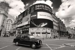 Black Cab And Video Advertising Billboards Of Piccadilly Circus, London. London, England - May 27, 2013: a black cab taxi crosses the iconic video advertising stock photo