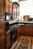 black cabinets kitchen stainless stove wood στοκ εικόνες