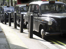 Black cabs. A line of London taxis Royalty Free Stock Photo
