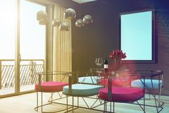 Black cafe interior, blue, red chairs corner toned Royalty Free Stock Photo