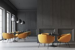 Black cafe interior, wall. Black cafe interior with a concrete floor, round black tables and yellow chairs. A blank wall fragment. 3d rendering mock up Stock Image